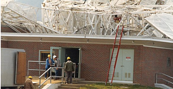 Workers remove equipment from 300-foot's control building