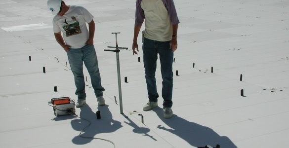 elescope Technicians J. D. Nelson and Nathan Sharp measure positions of GBT surface panels