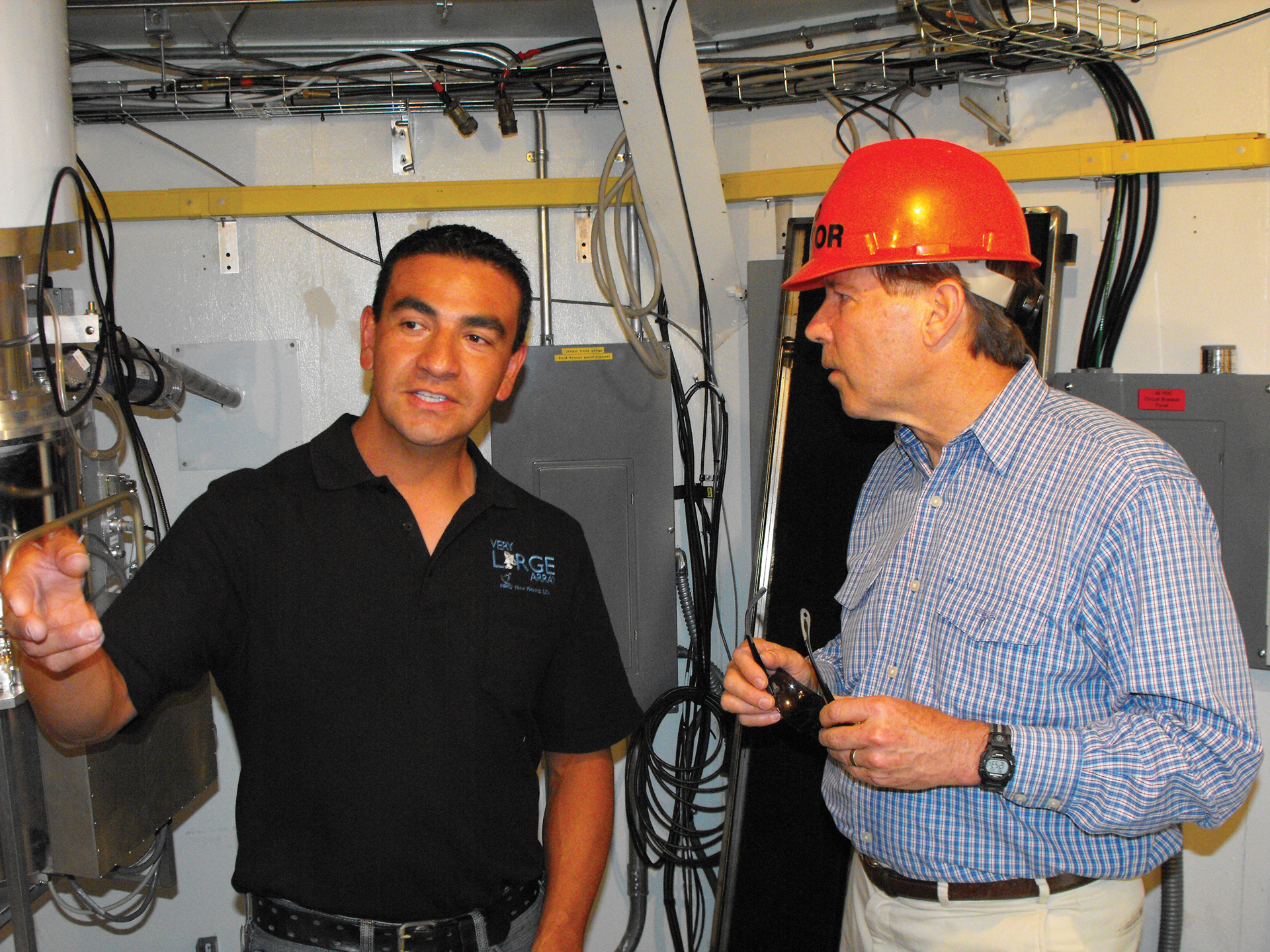 U.S. Senator Tom Udall and NRAO employee Eric Chavez