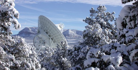 VLBA Pie Town antenna surrounded by snow-covered landscape