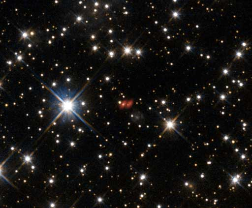 Active galaxy PKG 1830-211 as seen by the Hubble Space Telescope