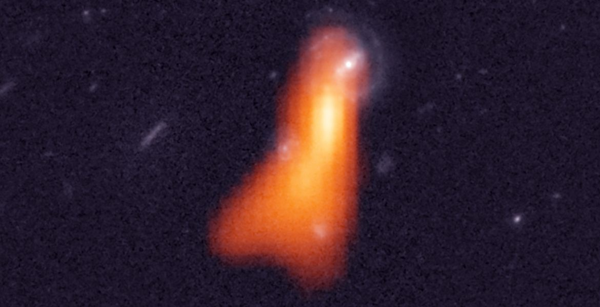 Radio-optical image of the galaxy J100054