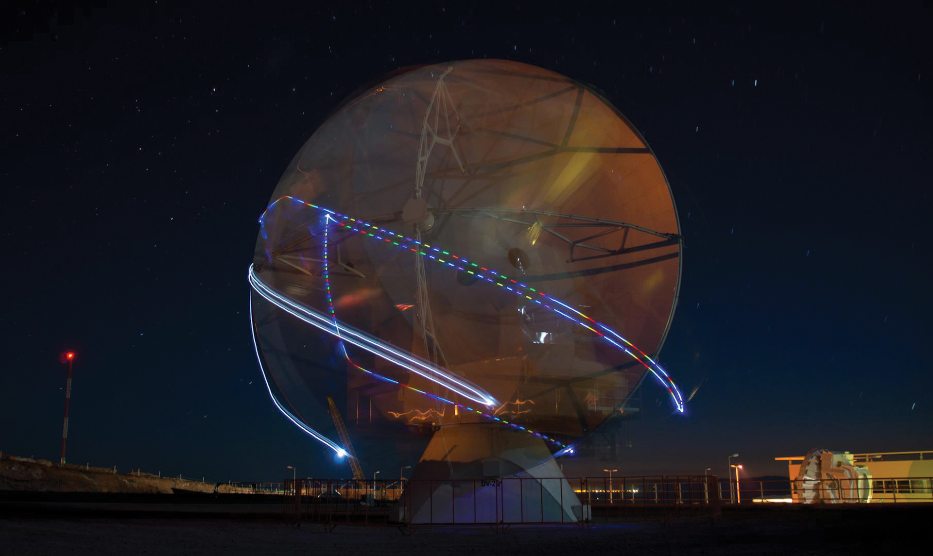 Long exposure photograph of lights placed on ALMA antenna