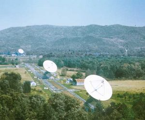 These three identical 85-foot dish antennas worked together as the Green Bank Interferometer, a testbed for the VLA. Two of the antennas can be hauled to different locations along the road linking them.