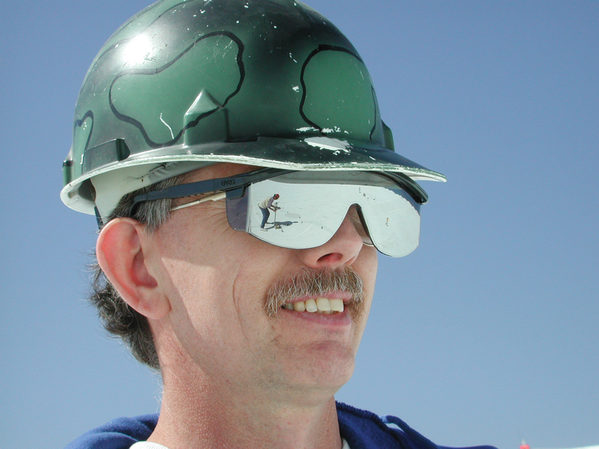 Telescope technician wearing safety sunglasses