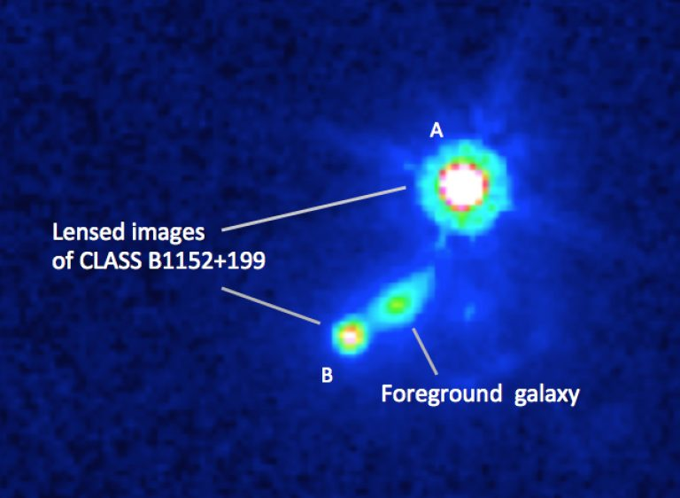 Hubble Space Telescope image of galaxy and gravitationally-lensed images.