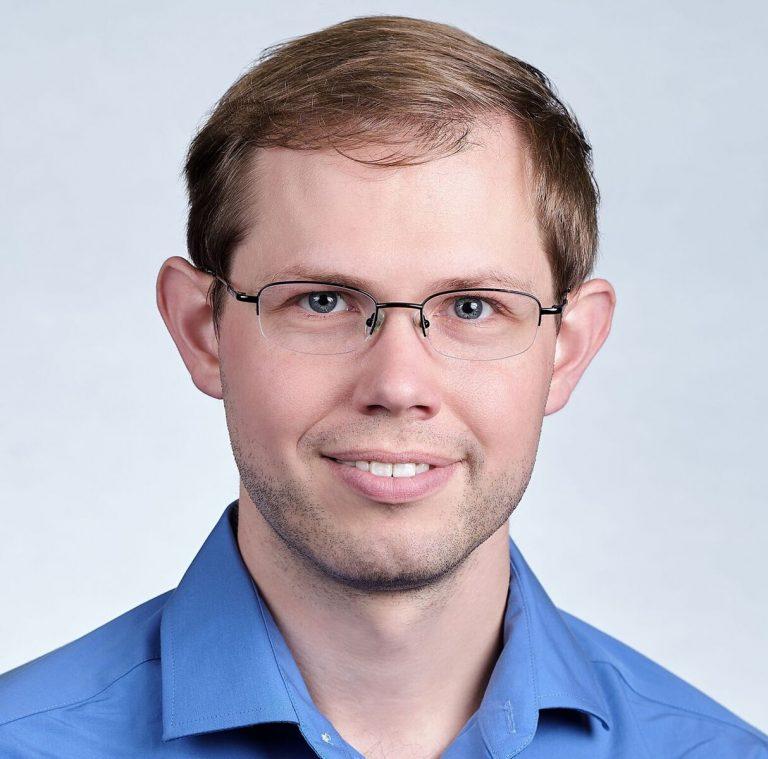 Dr. Brett McGuire