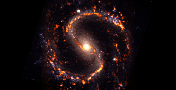 NGC 4535 is a grand design spiral galaxy with stellar bar morphology, s-shaped in red, orange, white and some purple elements shown in this composite